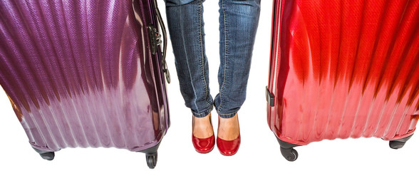 Female legs with luggage bags over white background
