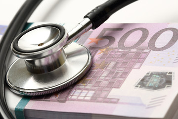 Stethoscope and euro banknotes cash closeup