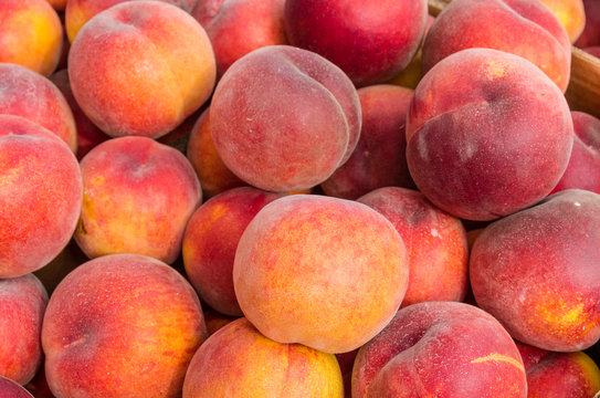 Fresh yellow peaches on display at the market