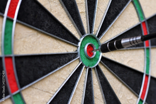 Wall mural dartboard with dart in the center