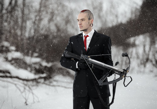 Hitman with a crossbow in an outdoor setting.  Walking Dead.