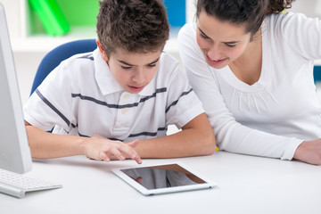 sister and brother playing game on tablet pc