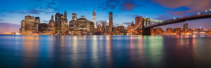 New York City skyline at night with Brooklyn Bridge