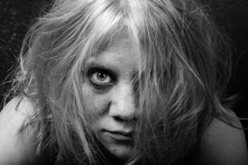 woman with freckles and tousled hair