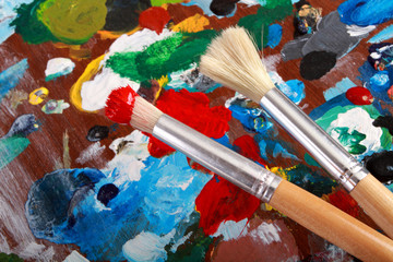 Artist palette and two paintbrushes