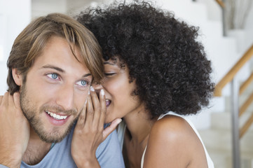 Woman whispering to a man