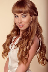 Hairstyle. Brown Hair. Beautiful girl with long Curly Hair. Happ