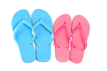male and female flip flops over white