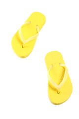 picture of yellow flip flops isolated on white