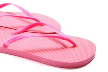 picture of pink summer flip flops over white