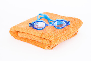 Towel and swimming glasses