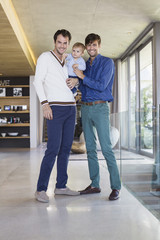 Parents smiling with their son at home