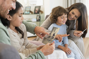 Parents showing photographs to their children