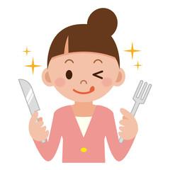 ナイフとフォークを持った女性