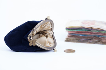 Purse with money isolated on a white backgrounds