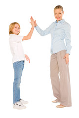 mum and son standing and smiling giving five isolated on white b