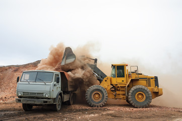 Loading truck with an excavator