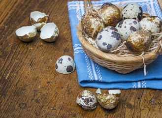 quail eggs in a basket on a table