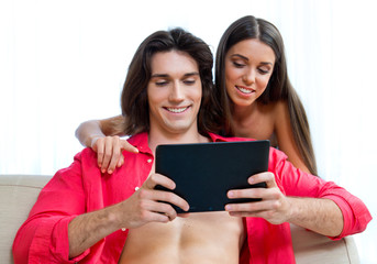 young couple with tablet