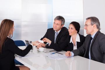 Businesswoman Offering Business Card