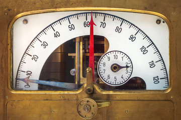 Vintage measurement instrument with a red needle indicator