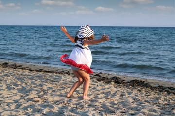Wall Mural - little girl running on beach