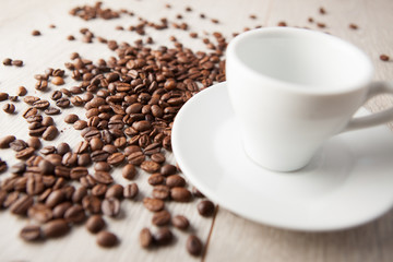 empty coffee cup with scattered beans
