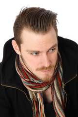 Young man in a scarf looking away