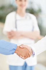 Welcome to the team. Close-up of male doctors handshaking while