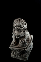 Chinese lion sculpture isolated on black background