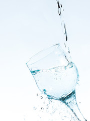 Water splashing in a glass , vertical