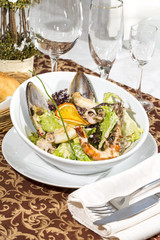 salad with vegetables and seafood on the table in a restaurant