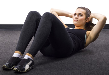 young Caucasian woman doing situps/crunches