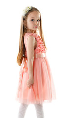 Charming little girl in pink dress and rim