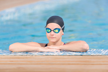 Female swimmer in blue water swimming pool. Sport woman.