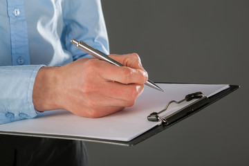 Businesswoman signing a contract