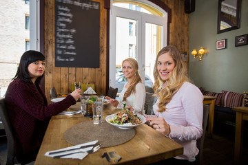 Female Friends Having Meal In Coffeeshop