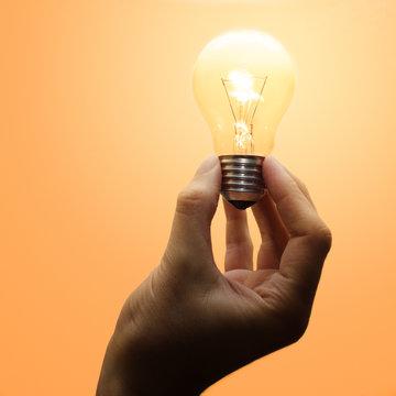 Luminescent light bulb in human hand
