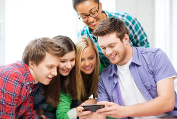 students looking at smartphone at school
