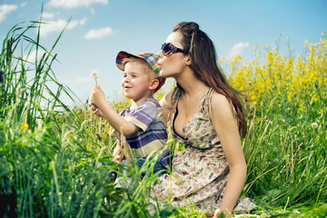 Family having a lot of fun with dandelions