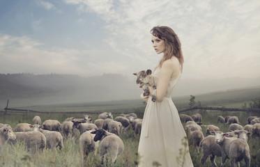 Sensual lady among sheeps