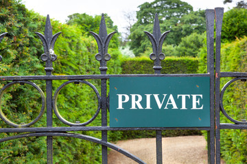 Private sign on a gate leading to a garden.