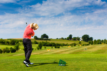 Young female golf player at Driving Range