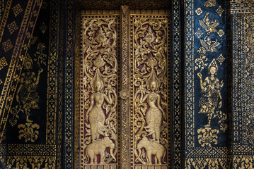 Buddhism Church Door and wall painting in Laos.