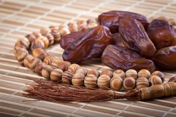 Dates and prayer beads close-up