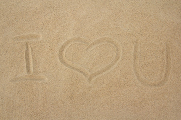 """i love you"" message on the sand"