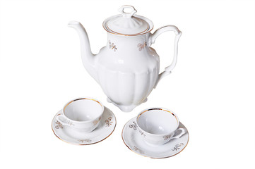 White porcelain teapot  and two cups- white background