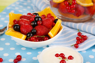 Useful fruit salad in glass cup and bowl