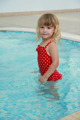 little girl in the water pool