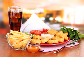 Fried chicken nuggets with vegetables,cola,french fries and